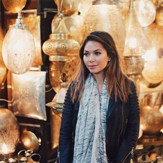 """Loving @Marianna Hewitt, of La La Mer, in our popular Graphite scarf! We're so happy you're making our scarves your """"go to"""" travel accessory!"""